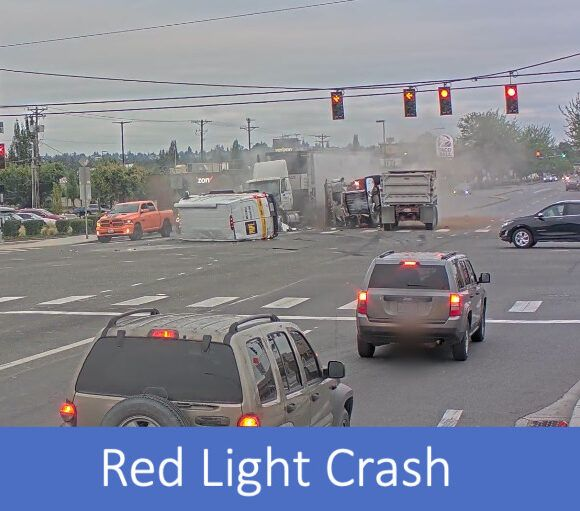 Image of truck crashed into other cars after running a red light