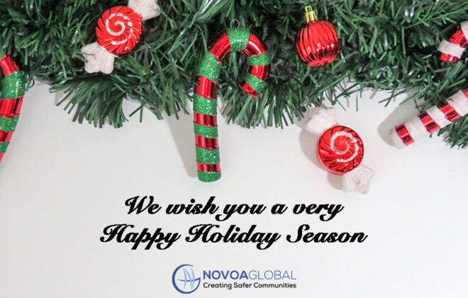 Image of greenery with candy canes and decorations and wording that says Happy holiday Season