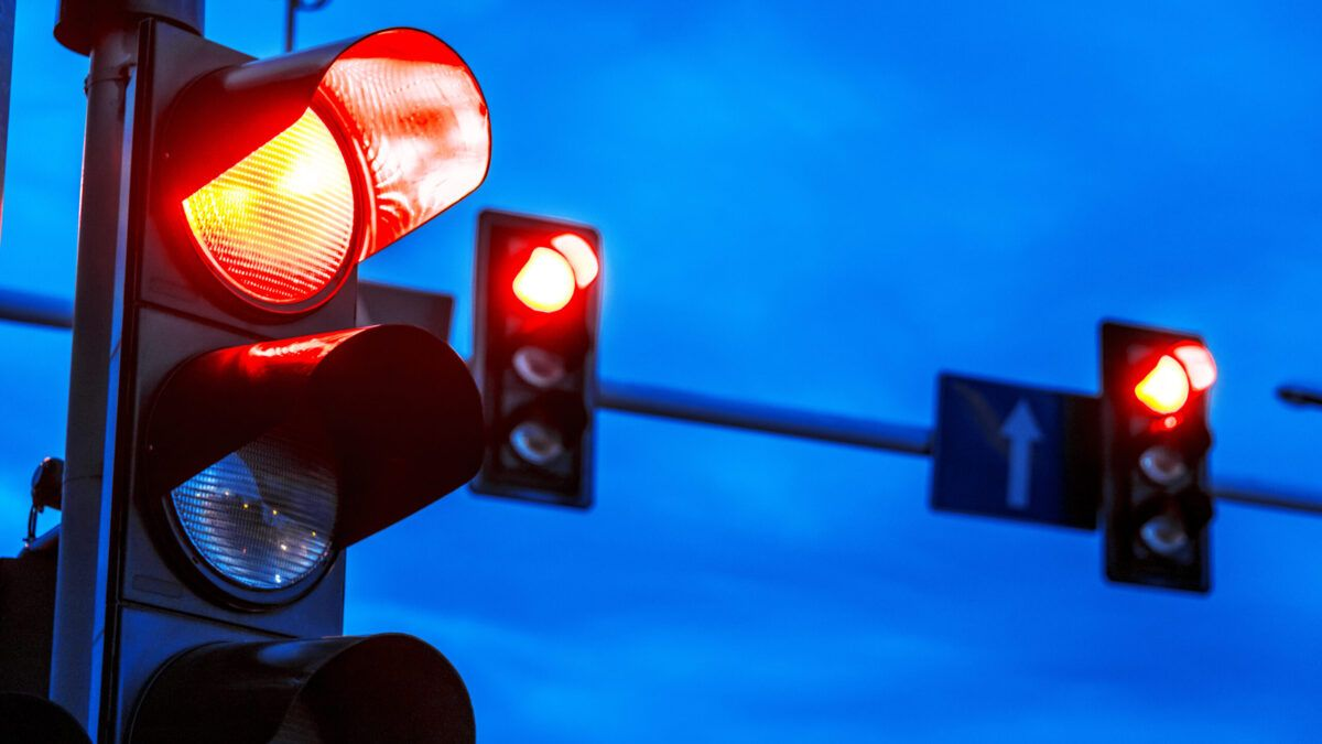 Image of traffic light on red at dusk