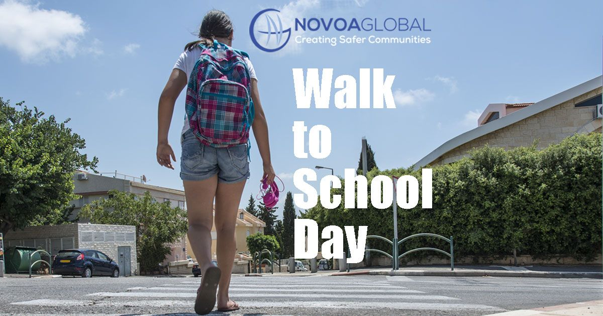 girl with backpack walking across the street at crosswalk