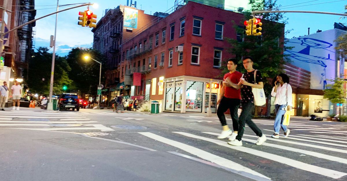 Young Adults walking in crosswalk at night
